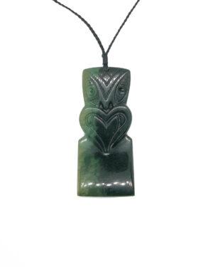 Pounamu greenstone Hei-tiki hand carved by Glen Surgenier